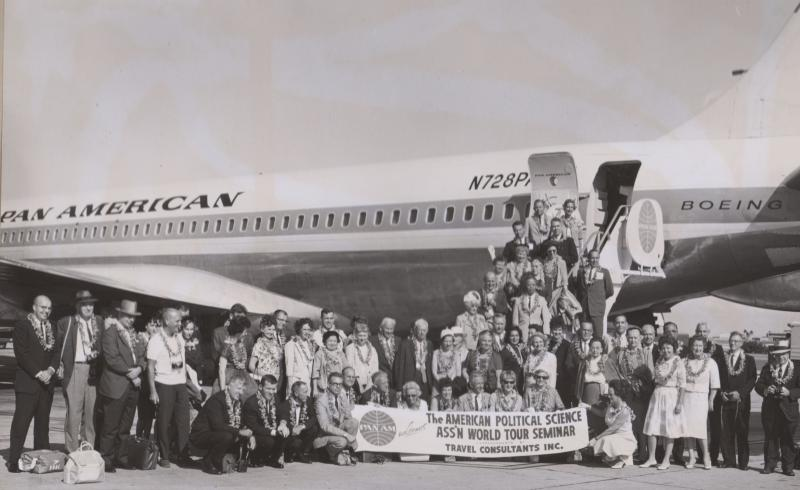 Members of the American Political Science Association World Tour Seminar standing in front of their plane.