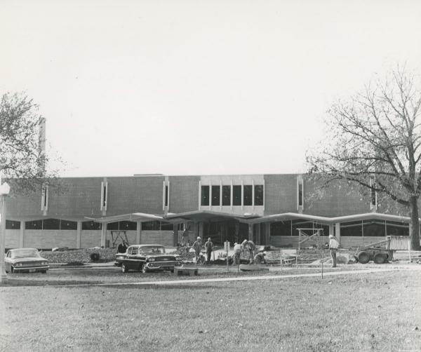 Sidewalk construction in front of Library, c. 1964.