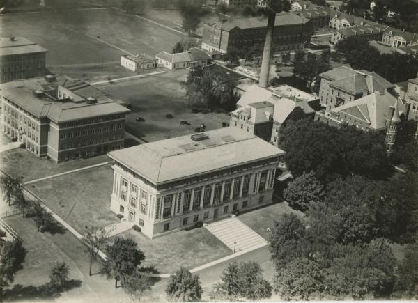 Aerial view with Seerley Hall in foreground. Oak is the dark shape behind white building at top center; Circle Elm is little above center. c. 1930