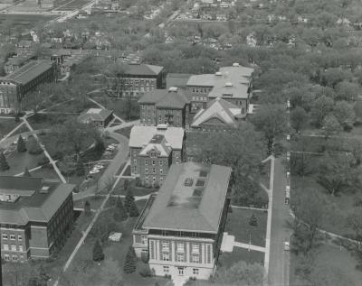 Airview; oak behind white building and left of East Gym c. 1942.