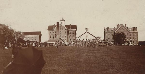 Military drill, 1892; the oak would eventually grow about where the cadets are drilling.