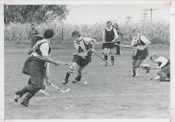Women playing field hockey, 1974
