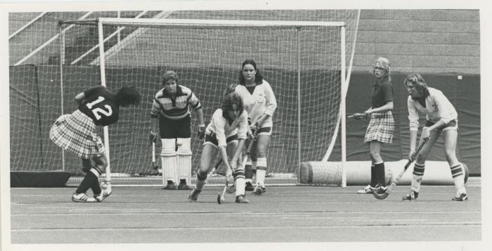 Women playing field hockey, 1979