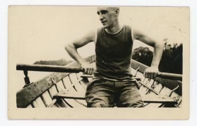 Eugene Francis Grossman photographed while rowing a rowboat. Eugene Francis Grossman photograph in the Eugene Francis Grossman Papers 1896-1965, #MsC-38, photographs of family and friends, box 1, University of Northern Iowa.
