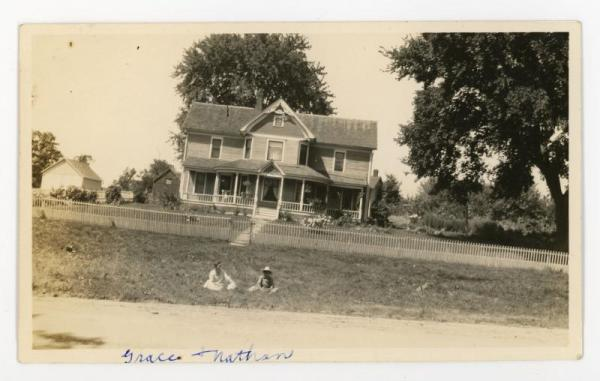 Grace and Nathan sitting on a lawn.