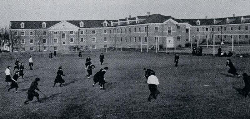 Women playing field hockey, 1924