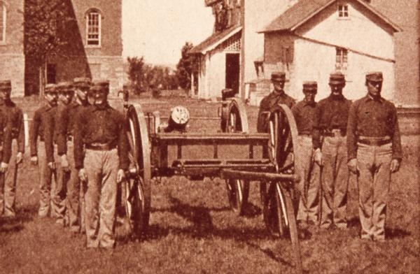 Student battalion posed with cannon