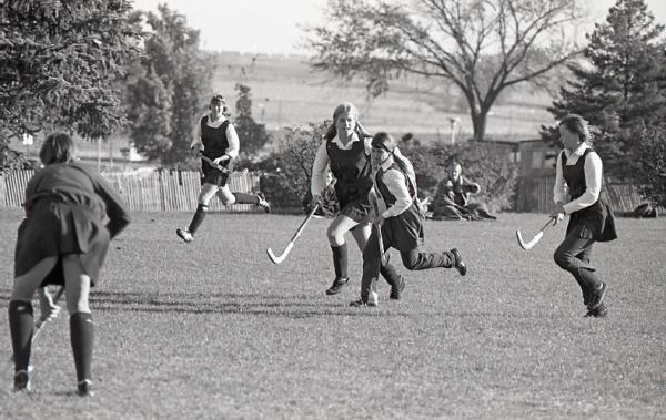 Women playing field hockey, 1972