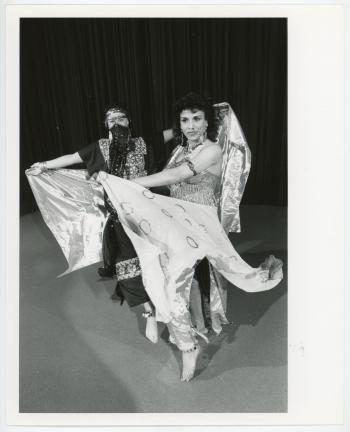 Two women dressed in traditional Indian dresswear.