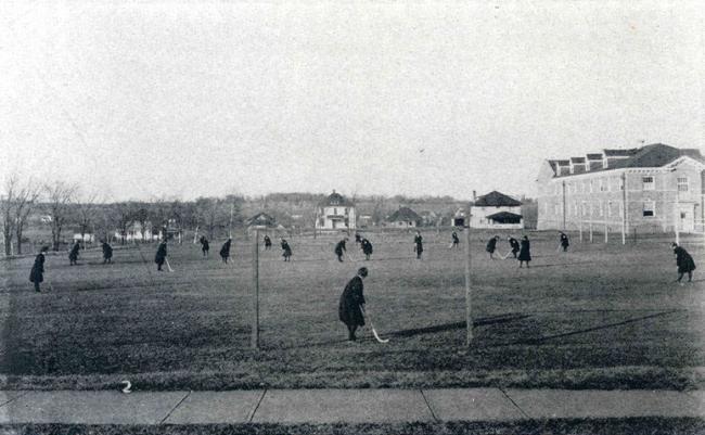 Women playing field hockey, about 1918.