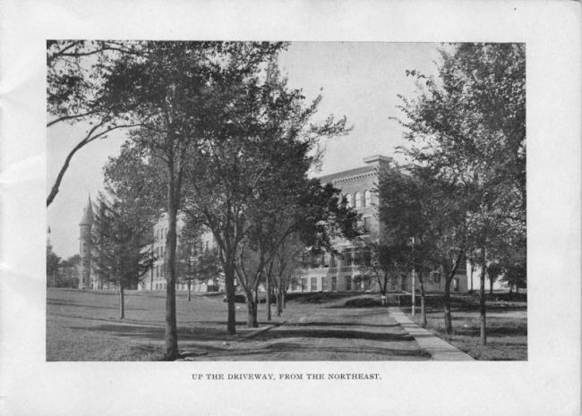 Up the driveway from the northeast:  Old Administration Building on left, and Auditorium Building (now Lang Hall) on right.